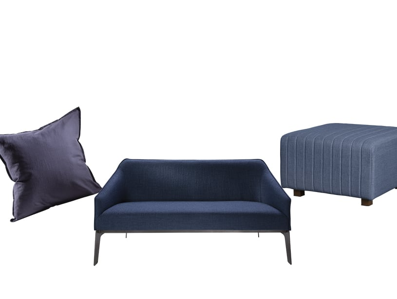 Blue pillow, ottoman and sofa