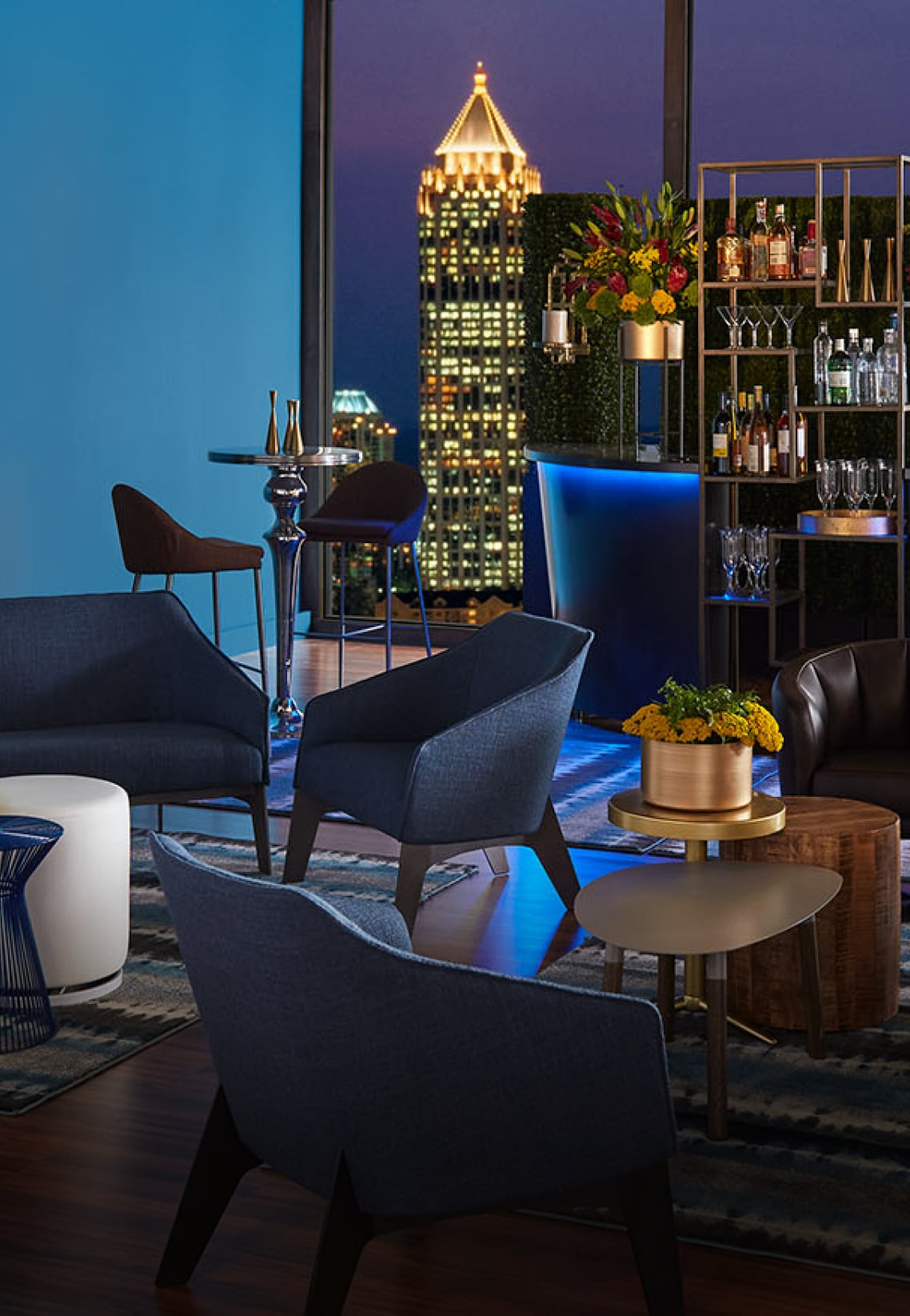 Night event with blue furniture and bar